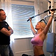 Blonde stunner in the gym gets her little shorts tugged down and her pert ass spanked crimson