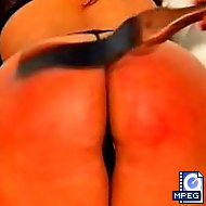 Mistress Gemini gives a hard spanking to beautiful bodied amazon