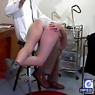 Shameful bare ass spanking for a big busted girl at the doctor's