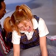Cute school girl in pain from a hard bare assed spanking