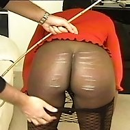 Black Honey in fishnets gets her round ass spanked and caned